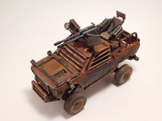 Datsun 510 post apocalypse truck with dual 50 caliber machine guns mounted to the roof.