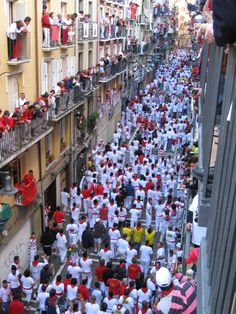 Running with the Bulls in Pamplona.