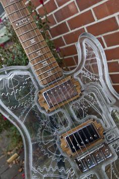Seriously Gorgeous Steampunk Guitar http://steampunkworkshop.com/seriously-gorgeous-steampunk-guitar #guitar #steampunk #music