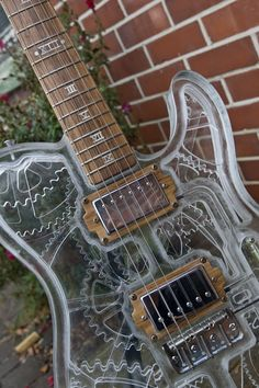 Seriously Gorgeous Steampunk Guitar http://steampunkworkshop.com/seriously-gorgeous-steampunk-guitar #guitar #steampunk #music
