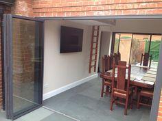 UltraSlim frame retractable slide and pivot glass doors - three doors open