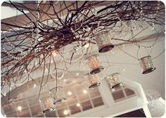 Maybe without so much tangled branches. But love the candles hanging from branches!