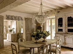 Crystal Chandelier and Distressed Furniture..Match made in Heaven