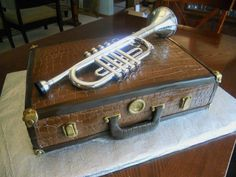 Trumpet and Trumpet Case Cake by SugaRush Desserts in Elkhart, Indiana Music Themed Cakes, Music Cakes, Music Themed Parties, Trumpet Case, Music Decor, Mouse Cake, Cakes For Men, Specialty Cakes, Drip Cakes