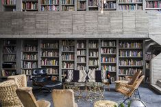 The library in Pedro Reyes and Carla Fernandez's Brutalist house in Mexico City via FvF | Remodelista
