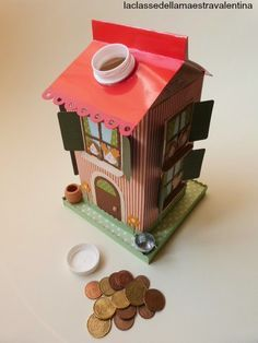"""""""Piggy bank"""" made from a recycled milk carton"""