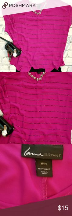 """NWOT LANE BRYANT 22/24 BLOUSE MAGENTA SHORT SLEEVE Women's Lane Bryant size 22/24 or 2xl-3xl. Gorgeous magenta/fuschia short sleeve semi sheer blouse with black rhinestones. Has a slit on back on bottom about 7-12"""" in length. Flowy. In perfect condition. BUY MORE AND SAVE! PLZ CHECK OUT MY OTHER LISTINGS Lane Bryant Tops Blouses"""