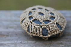 River Rock Series - Large >> Natural river rock encased in soft thread >> Each design is specific to the rock shape DIMENSIONS Length: 2.75 inches Width: 2.5 inches © The Roving Nomad Est. 2014