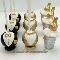 New Years Anniversary party cake pops - Gold Set  #champagneonice #champagne #champagnecakepops #newyearcakepops #newyearscakepops #glamcakepops #tuxedocakepops #tuxedos #anniversarycakepops #icebucket #icebucketcakepops #blackandgold #gempops #cakepop #cakepops #instacakepop #instacakepops #cakepopstagram #cake #instacake #cookies #sugarcookies #decoratedcookies #followme #candy #sweet #dessert #sweettooth #lollicakes #cakepopping