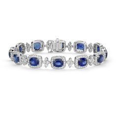 A great complement to any style, this one-of-a-kind bracelet showcases vibrant blue sapphire gemstones accented with a sparkling halo of pav-set diamonds frame…