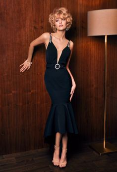 e7ad8c82ad165b A mermaid style cocktail dress with deep plunging neckline with built-in  belt is classy