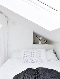 Clean white small attic apartment with vibrant pops of color