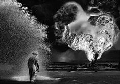Sebastiao Salgado, Chemical sprays protect this fire fighter. Greater Burhan, Kuwait . 1991