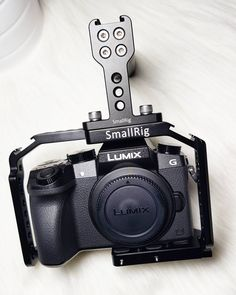 SMALLRIG Panasonic Cage is a specialized cage for Panasonic Lumix It wraps securely around the camera body, preventing unwanted rotation. The specialized cage for is light and solid, it will fit your camera perfectly. Antique Cameras, Hdmi Cables, Camera Accessories, Walkie Talkie, Clamp, Videography, Cinematography, Digital Camera, Wraps