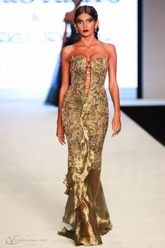 """https://www.cityblis.com/10898/item/12436   Green - $810 by ZulaStudio   Designer brocade in green/gold palette evening gown with square arm holes, with metallic olive green organza skirt and open vertical front adorned with large green crystals from """"London Bridge"""" collection     #Dresses"""