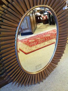 Fun new mirror at Traditions. Unique framework.