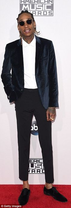 Suited up: Nick Jonas, Wiz Khalifa and actor Norman Reedus showed their personal style fla...
