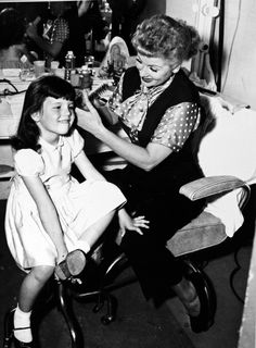 Lucille Ball doing daughter Lucie Arnaz's hair on the set of I Love Lucy