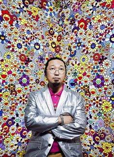 "This is a photograph of Takashi Murakami in front of one of his highly sought after ""superflat"" style paintings."