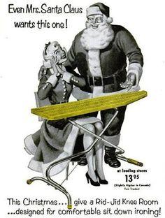 enhanced-buzz-8893-1387588913-7 Il s'ennuie pas le père Noël. Sa femme – qui doit faire 17 ans à tout casser – voulait vraiment cette table à repasser