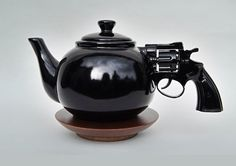 'Let's Talk It Over' teapot by Dennis Shields  http://designtaxi.com/news/351391/Surreal-Teapot-Has-Pistol-As-Handle/