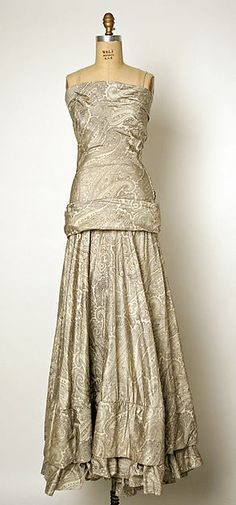 Evening dress House of Balenciaga  (French, founded 1937) Designer: Cristobal Balenciaga (Spanish, Guetaria, San Sebastian 1895–1972 Javea) Date: 1937 Culture: French Medium: silk Dimensions: Length at CB: 60 in. (152.4 cm) Credit Line: Gift of Mrs. Leon L. Roos, 1966 Accession Number: C.I.66.58.2