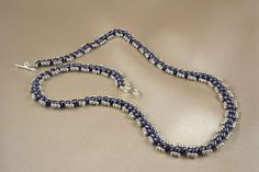 Simple and pretty necklace of Twin Beads and seedbeads. Why not try it?