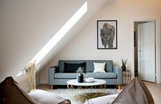 Kaja's Simple, Airy Oslo Loft  perfect couch.