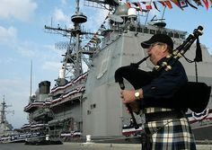 Norfolk, Va. (Oct. 29,2004) - John Ickes of Virginia Beach, Va., plays the bagpipes before the start of the change of command ceremony for the guided missile cruiser USS Normandy (CG 60). Capt. Stephen W. Hampton relieved Capt. Matthew J. Streeter during a ceremony on board Naval Station Norfolk, Virginia. U.S. Navy photo by Photographers Mate Airman Timothy Bensken (RELEASED)