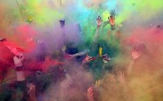 People enjoy sprinkling themselves with coloured powder during an annual Festival of Colours in Moscow. Dmitry Serebryakov / AFP / Getty Images