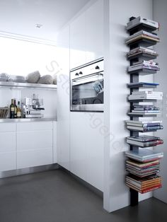 cook books - Still easy to get to.  Not a lot os space - I like this idea.
