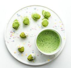 Matcha green tea mini madeleines with white chocolate and a bowl of matcha