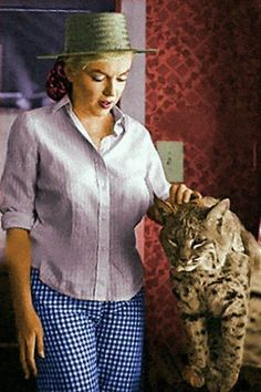 Marilyn and a bobcat... Not exactly your typical cat - but it does purrr