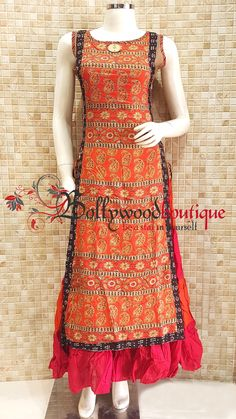 Ethnic Dress 28 Fabric : Cotton Reyon. Color : Multi Color. Style : Ethnic Style. Product Details : Look gorgeous in this multi colored designer style dress in center panel style. Ideal for kitty parties or small get togethers. Price : Rs: 2900 /-