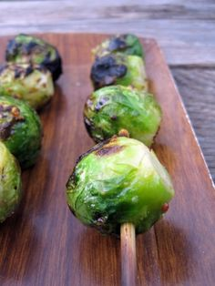 Bring a large pot of water to a boil. Blanch the sprouts for 3-4 minutes. Plunge into an ice bath.  Allow to marinate for 30 minutes.  Grill for 3-5 minutes on each side, or until the sprouts are nicely charred on all sides.