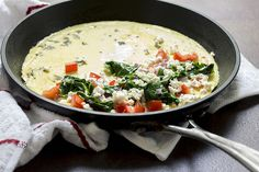 Recipe:+Skinny+Greek+Omelet:1 egg white/ 1 whole egg/ 1 fresh basil leaf diced/ 1 Tbsp water/ 1 Tbsp red onion diced /1 cup spinach/ ¼ cup tomato diced/ 2 Tbsp crumbled feta/ nonstick cooking spray salt and black pepper, to taste