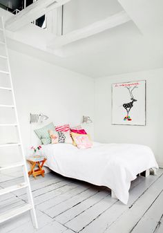 love the painted floors and bright colors against the white