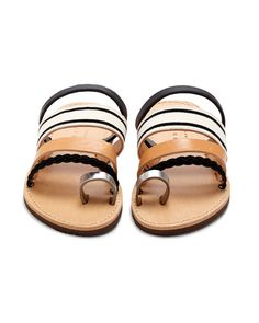 The 'Gerbera' slide sandals by Isapera is crafted with a single toe strap and arch straps in woven fabric and leather. The minimalist design of these beautiful leather sandals will go with just about