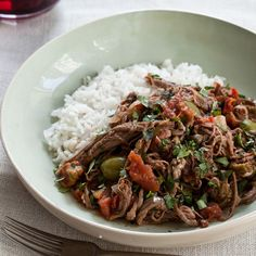 Slow Cooker Ropa Vieja | This Cuban stew, featuring shredded flank steak, tomatoes and olives, can be made up to two days in advance.