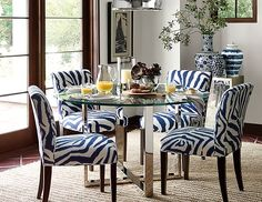 Navy patterned chairs in dining room.  Blue and white vases.
