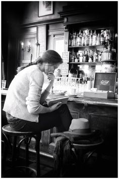 "Reading at bar in Amsterdam. Photograph by Edwin Loekemeijer.  ""Street photographer. Wandering around. Always observing. Trying to catch special moments. Seeing, feeling and absorbing the world around me. A passion for photography."