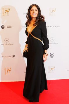 November 22 2012 Salma Hayek wore a plunging black and gold dress to attend the Bambi 2012 Media Awards in Duesseldorf. Salma Hayek Body, Telenovela Teresa, Mercedes Benz, Selma Hayek, Celebrity Photography, Glamour, Celebrity Look, Dress And Heels, Colorful Fashion