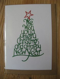'We Wish you a Merry Christmas' paper cut Christmas card designed by Christine Green