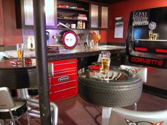 Auto themed Man Cave. Diamond plate on cabinets, tool cabinets and tires as base for tables. Very cool.