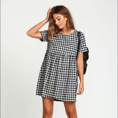 Plaid baby doll dress Black and white plaid baby doll dress with leather detail on neckline. Price is firm. Dresses