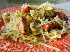 This special sausage adds a lot of color to this dish. Serve with some steamed broccoli and melted cheddar. 12 oz. spinach chicken sausage, sliced 1 box farfalle pasta 1/2 c. basil pesto 2-4 oz. Pa...
