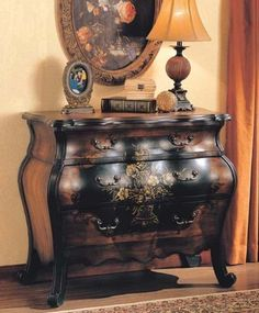 "Entry Way Accent Bombe Chest Black & Walnut Finish by Acme Furniture. $489.00. Entry Way Accent Bombe Chest Black & Walnut Finish. Entry Way & Foyer->Bombe Chests. Some assembly may be required. Please see product details.. Entry Way & Foyer. Dimension: 37""W x 17""D x 34""H Finish: Black, Walnut Material: Wood Entry Way Accent Bombe Chest Black & Walnut Finish Item features three storage drawers and floral pattern at the middle. Curved design edge and legs. Assembly re..."