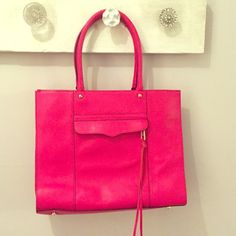 Rebecca Minkoff Medium MAB Tote PINK 100% authentic Rebecca Minkoff MEDIUM MAB TOTE IN BRIGHT PINK! Soft pink leather! Brand New, never used! Only flaw is manufacturers flaw, small imperfection on straps! (shown in last picture) Great condition, great price! I will consider offers made with the offer button only. No trades... Thanks for looking around my closet. ❤️ I just added lot of new items!  Rebecca Minkoff Bags Totes
