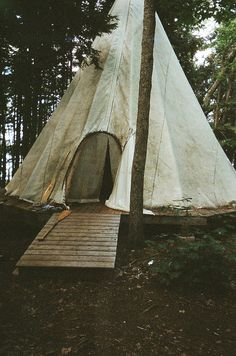 This is EXACTLY what the Teepee I grew up in looked like! With the raised deck and everything! WOO! The only difference is that we didn't have a ramp leading up to it, and we put a hole in the middle for a huge fire pit. Ahhh wonderful memories.... I'll have to get a teepee for my kids...<3 <3