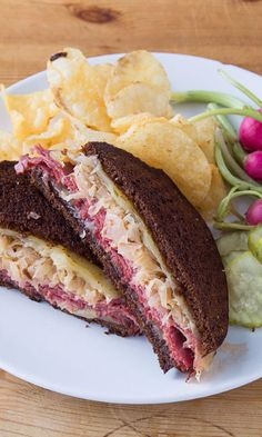Pressing down on this sandwich with a spatula while it toasts in the pan is the key to achieving the outer crispness and well-melted cheese that you want in a Reuben. Pile the meat on generously but n (Sandwich Recipes)